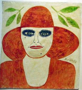 portraitblue-eyed-woman-in-orange-top-and-hat